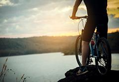 Cyclist Man Racing Bike on Mountain